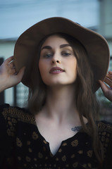 Beautiful girl with vintage dress and hat
