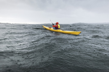 Person kayaking on sea