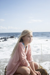 Girl sitting on coast