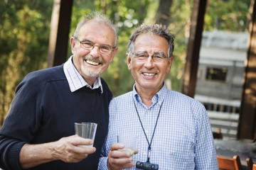 Two smiling senior men