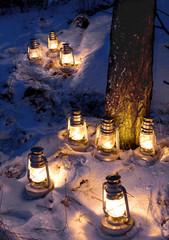Illuminated lanterns on snow