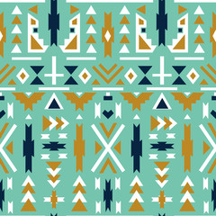 Seamless colorful aztec pattern. Green background.