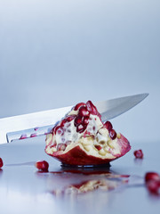 Pomegranate and knife