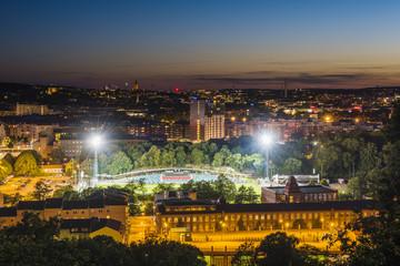 High angle view of illuminated city at dusk