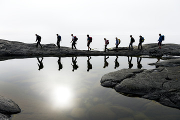 Group of people hiking by lake