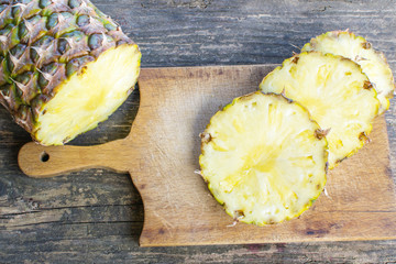 Pineapple fruit cut on wooden table