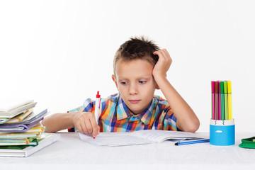 Tired school boy doing homework