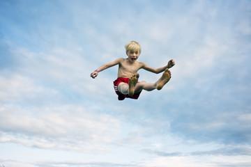 Boy jumping mid-air