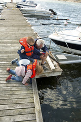 Grandfather mooring boat with children