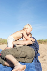 Father playing with son on beach