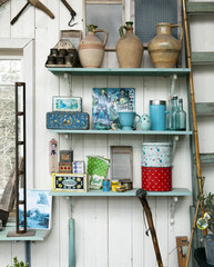 Containers and vases on wooden shelves
