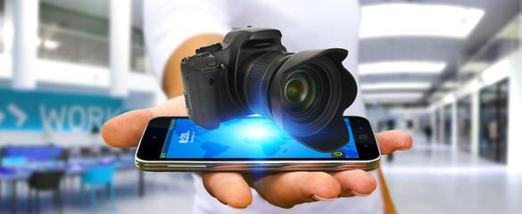 Young man using modern camera