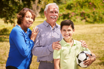 Portrait Happy Family Grandparents And Boy With Soccer Ball