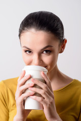 Positive girl drinking coffee