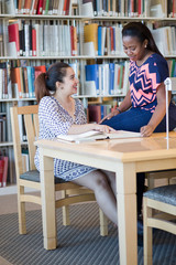 Two Students interacting in library