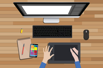 graphic design workspace with digital sketching and monitor