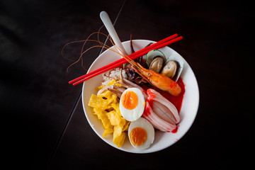 Pink seafood flat noodles.