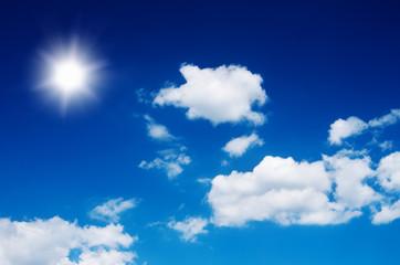 Sun in bright blue sky.