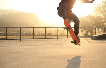skateboarding woman at sunrise skatepark
