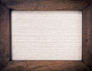 Vintage wooden frame with hessian texture background