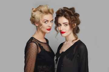 blonde and brunette girls with natural make-up and red lips