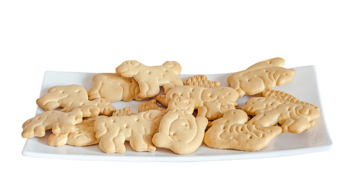 Biscuits for childrens, animal shape, white plate, isolated