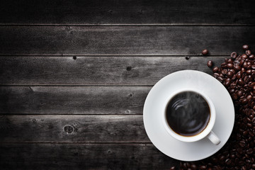 a cup of coffee on vintage wooden table