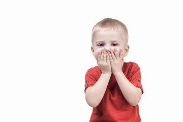 cute child boy surprised by something and closed mouth hands. teenager on white background