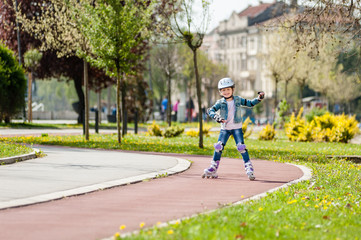 Little girl on inline skates