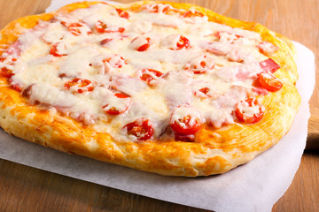 Ham and tomato homemade pizza,