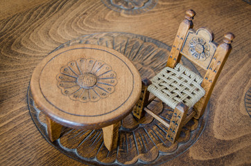 Fine art .Miniature wooden hand made chair and table on carved table