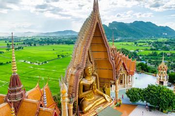 Gold big buddha statue temple wat tham sua, tha moung, kanchanaburi, thailand