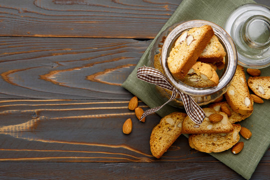 Italian cantuccini cookie with almond filling on wooden background