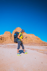 Woman Hiker with backpack and GPS