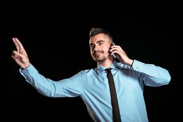 Handsome businessman on black background
