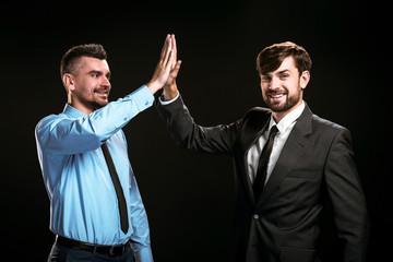 Handsome businessmen on black background