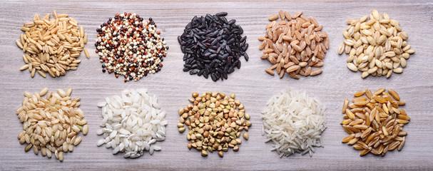 Grains. From left: oats, quinoa, black rice, spelled, barley, brown rice, carnaroli rice, buckwheat, basmati rice, wheat khorasan