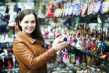 Woman choosing souvenir