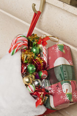 christmas stocking full of gifts and candies