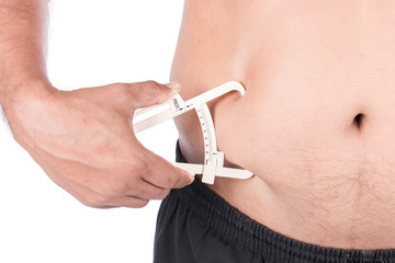 Young Man Measuring Fat Belly With Fat Caliper