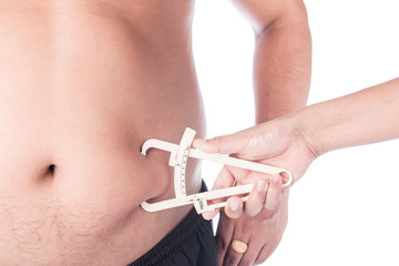 Hand Women Measuring Fat Belly With Fat Caliper Of Young Man