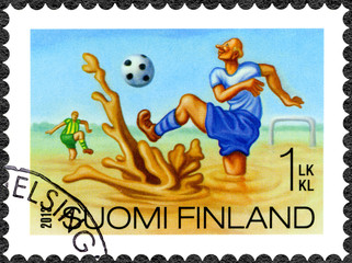 FINLAND - 2013: shows swamp football, series Finnish Oddity