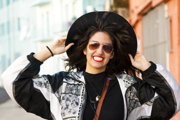 cheerful girl on city street fashion