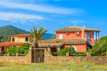 Traditional holiday villa houses on Capo Boi beach, Sardinia island, Italy