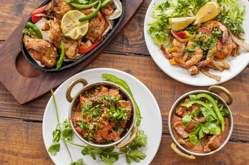Selection of curry dishes with meat and prawns