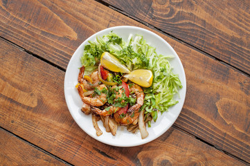 King prawns dish with salad