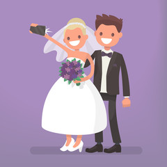 The bride and groom make selfie. Photo of happy newlyweds