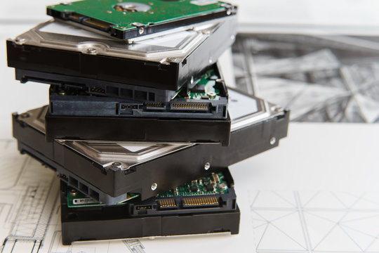 pile of  hard drives at white background