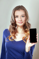 woman shows a look at a smartphone