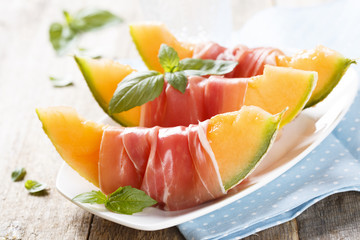 Melon with ham and basil